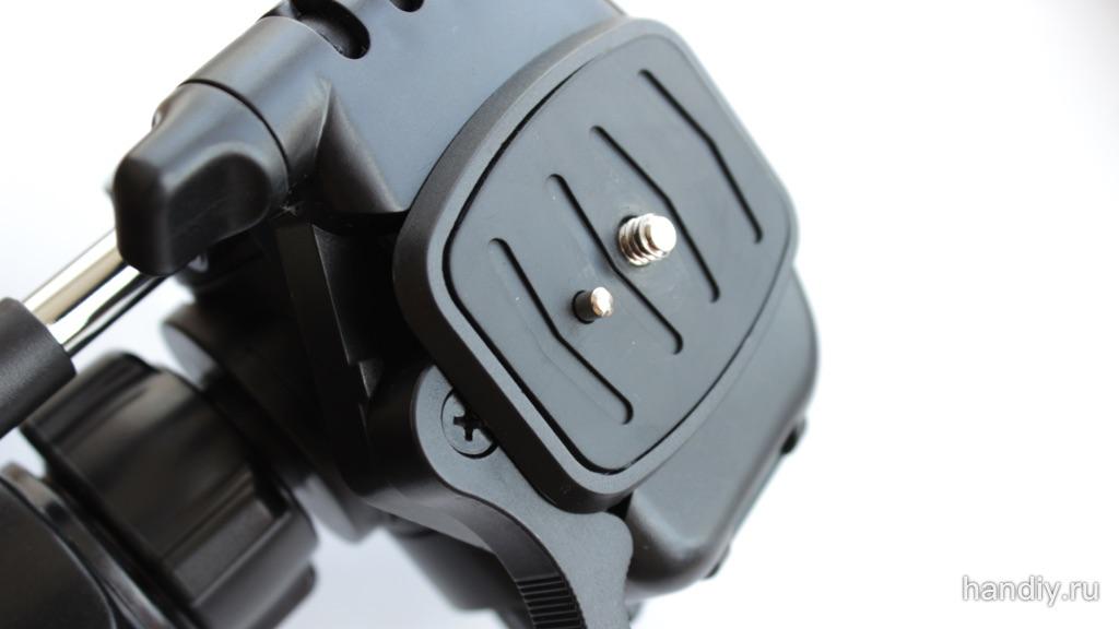 Фотография штативная головка с винтом крепления фотоаппарата или видеокамеры